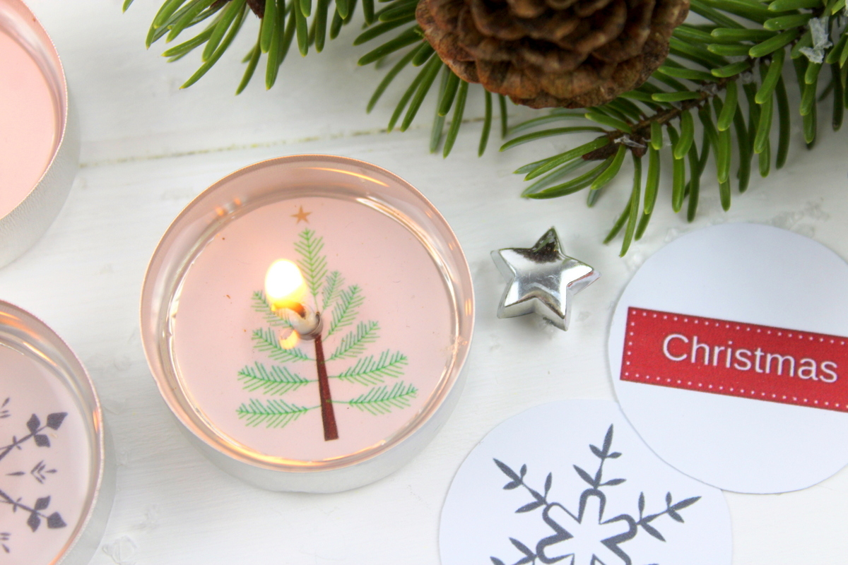 Teelichter mit weihnachtlichen Bildern und versteckter Botschaft
